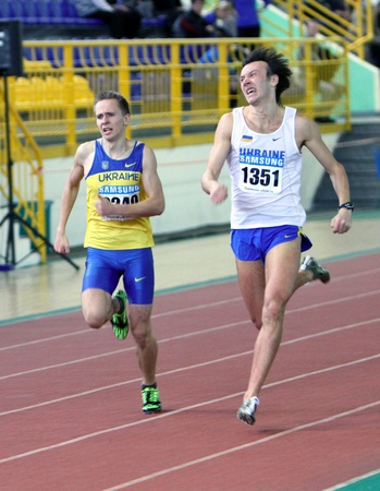 Pozdnikov Aleksei and Tindik Andrei fight at the finish of the 400 meters dash on Ukrainian Track   Field Championships on February 16, 2012 in Sumy, Ukraine