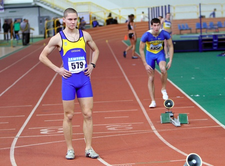 SUMY, UKRAINE - FEB 16   L-R  Perepiatenko Aleksei and Melnik Andrei on the start of the 400 meters dash on Ukrainian Track   Field Championships on February 16, 2012 in Sumy, Ukraine   Stock Photo - 12662745