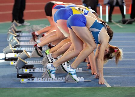 sumy: Unidentified girls on the start of the 60 meters dash during the Ukainian Track and Field Championships on February 17, 2012 in Sumy, Ukraine.