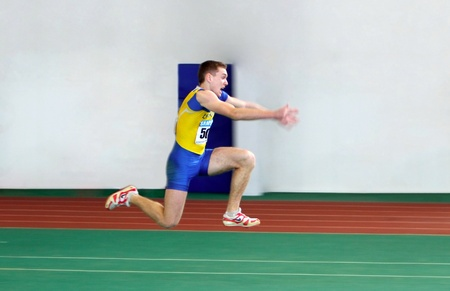 sumy: Negryi Mykyta on the triple jump on the Ukrainian Track and Field Championships on February 18, 2012 in Sumy, Ukraine.