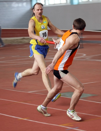 Unidentified men at the relay race on Ukrainian Veteran Track   Field Championships on March 03, 2012 in Kiev, Ukraine