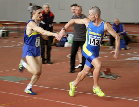 Unidentified men at the relay race on Ukrainian Veteran Track   Field Championships on March 03, 2012 in Kiev, Ukraine  Stock Photo - 12662751