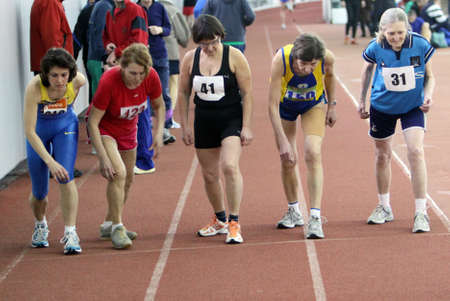 Unidentified women at the start of the 1500 meters race on Ukrainian Veteran Track   Field Championships on March 03, 2012 in Kiev, Ukraine  Stock Photo - 12662750