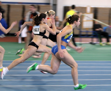 Unidentified girls on the  60 meters dash during the Ukrainian Track and Field Championships on February 17, 2012 in Sumy, Ukraine