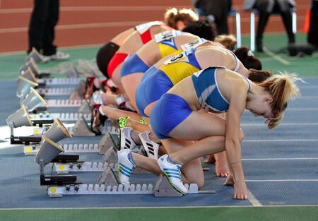 sumy: Unidentified girls on the start of the 60 meters dash during the Ukrainian Track and Field Championships on February 17, 2012 in Sumy, Ukraine   Editorial