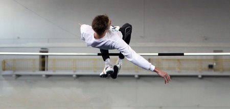 Krymarenko Yuriy, the World Champion in Helsinki 2005, competes in high jump during the Ukrainian Track and Field Championships on February 16, 2012 in Sumy, Ukraine