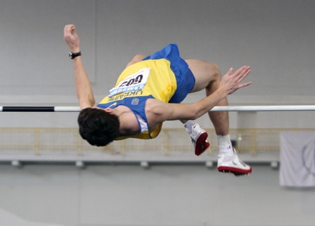 Pubel Andrei competes in high jump during the Ukrainian Track and Field Championships on February 17, 2012 in Sumy, Ukraine