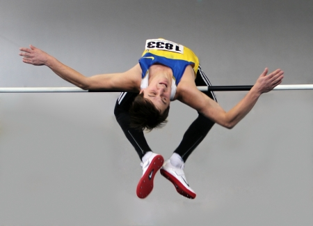 Sayevych Anton competes in the high jump competition during the Ukrainian Track and Field Championships on February 17, 2012 in Sumy, Ukraine   Stock Photo - 12848588