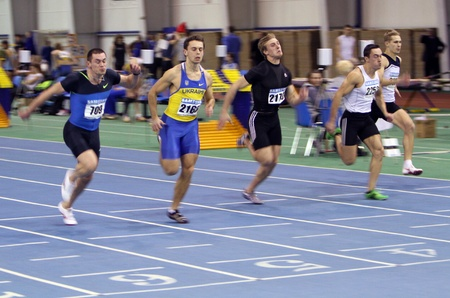 Unidentified men on the finish of the 60 meters dash during the Ukrainian Track and Field Championships on February 17, 2012 in Sumy, Ukraine Stock Photo - 12848611