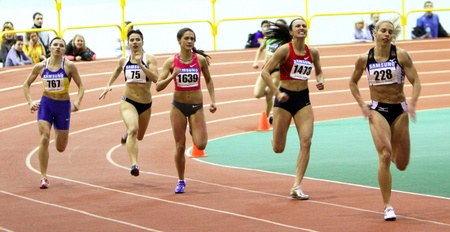 sumy: Unidentified girls on the 400 meters dash during the Ukrainian Track and Field Championships on February 17, 2012 in Sumy, Ukraine