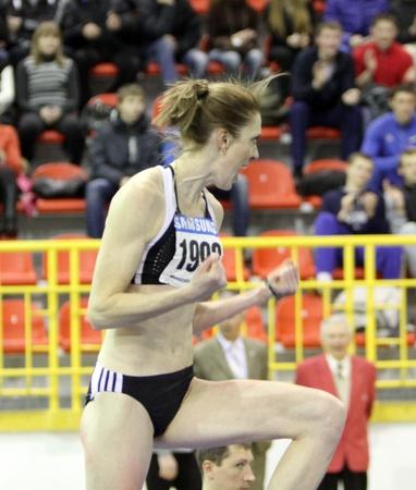 Holosha Olena celebrates her third place with 1 90 on Ukainian Track and Field Championships on February 16, 2012 in Sumy, Ukraine Stock Photo - 12848594