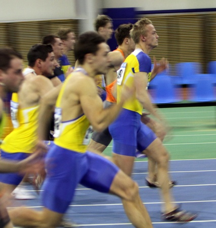 sumy: Unidentified men on the finish of the 60 meters dash during the Ukrainian Track and Field Championships on February 17, 2012 in Sumy, Ukraine Editorial