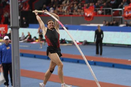 DONETSK, UKRAINE - FEB.11: Maksym Mazuryk competes in the Samsung Pole Vault Stars meeting on February 11, 2012 in Donetsk, Ukraine. He won silver medal in the pole vault event at 2010 European Championships.