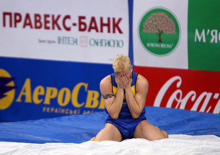 DONETSK, UKRAINE - FEB 11  Denys Yurchenko on the Samsung Pole Vault Stars meeting on February 11, 2012 in Donetsk, Ukraine  He won bronze medal in the pole vault event at Summer Olympics in Beijing   Stock Photo - 12848659