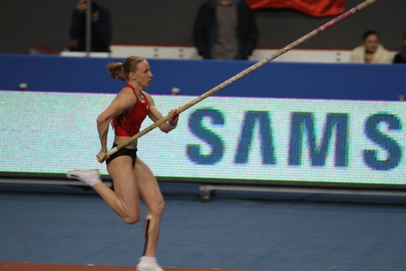 DONETSK,UKRAINE-FEB 11  Svetlana Feofanova - Russian World Champion, silver and bronze medalist of Olympic Games compete on Samsung Pole Vault Stars meeting on February 11, 2012 in Donetsk, Ukraine