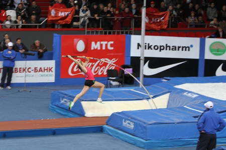 samsung: DONETSK,UKRAINE-FEB 11  Shelekh Hanna, bronze medalist of 1st Youth Olympic Games wins third place with Nation Rekord 4 60 on Samsung Pole Vault Stars meeting on February 11, 2012 in Donetsk, Ukraine   Editorial