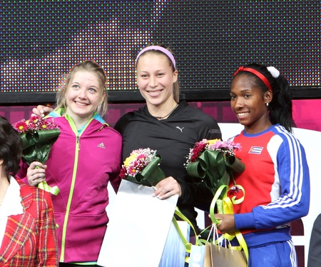 DONETSK, UKRAINE - FEB 11   L-R  Shelekh Hanna, Ptacnikova Jirina, Yarisley Silva on the Closing Ceremony of the Samsung Pole Vault Stars meeting on February 11, 2012 in Donetsk, Ukraine