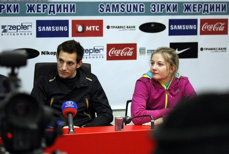 samsung: DONETSK, UKRAINE - FEB 11   L-R  Lavillenie Renaud and Shelekh Hanna on the press conference after Samsung Pole Vault Stars meeting on February 11, 2012 in Donetsk, Ukraine