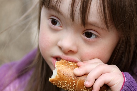 Portrait of beautiful girl that eating baguette photo