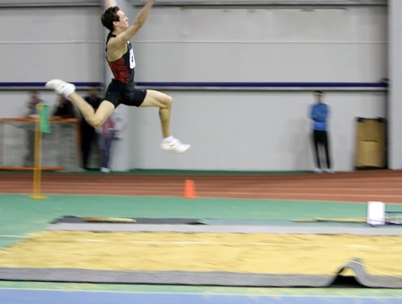 sumy: SUMY, UKRAINE - FEB 17  Makarchev Andriy wins second place the long jump on the Ukrainian Track and Field Championships on February 17, 2012 in Sumy, Ukraine