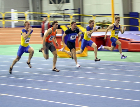 sumy: SUMY, UKRAINE - FEB 17  Unidentified men on the finish of the 60 meters dash during the Ukrainian Track and Field Championships on February 17, 2012 in Sumy, Ukraine