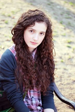 Portrait of beautiful young girl in the park. Stock Photo