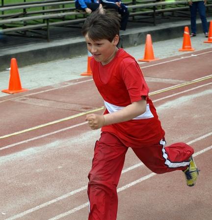 athletic activity: The Running boy  Stock Photo