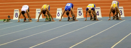 sumy: SUMY,UKRAINE-FEB 16  Unidentified men on the start of the 60 meters dash during the Ukrainian Track and Field Championships on February 16, 2012 in Sumy, Ukraine  Editorial