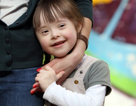 Down Syndrome: Happy family moments - Mother and child have a fun