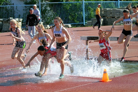 steeplechase: YALTA, UKRAINE - APRIL 27  unidentified girls compete in the 2000 Meter Steeplechase for girls age 16-17 on Ukrainian Junior Track and Field Championships on april 27, 2012 - Yalta, Ukraine