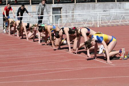 YALTA, UKRAINE - APRIL 25  Unidentified girls age 16-17 on the start of the 100 meters race on Ukrainian Junior Track and Field Championships on April 25, 2012 in Yalta, Ukraine