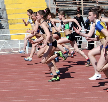YALTA, UKRAINE - APRIL 25  Unidentified girls age 16-17 on the 100 meters race on Ukrainian Junior Track and Field Championships on April 25, 2012 in Yalta, Ukraine