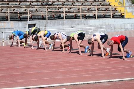 YALTA, UKRAINE - APRIL 25  Unidentified boys age 16-17 on the start of the 100 meters race on Ukrainian Junior Track and Field Championships on April 25, 2012 in Yalta, Ukraine
