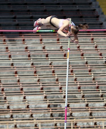 Zuzina Olga, age 17 compete in the pole vault competition on Ukrainian Junior Track and Field Championships on april 25, 2012 - Yalta, Ukraine   Stock Photo - 13436609