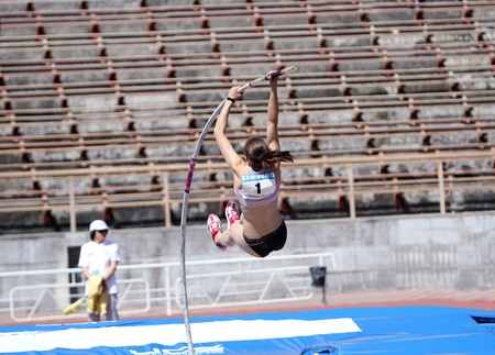 YALTA, UKRAINE - APRIL 25  Zuzina Olga, age 16-17 compete in the pole vault competition on Ukrainian Junior Track and Field Championships on april 25, 2012 - Yalta, Ukraine  Stock Photo - 13436621