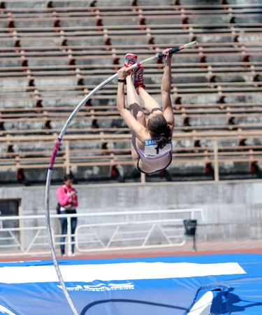 YALTA, UKRAINE - APRIL 25  Zuzina Olga, age 16-17 compete in the pole vault competition on Ukrainian Junior Track and Field Championships on april 25, 2012 - Yalta, Ukraine