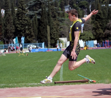 YALTA, UKRAINE - APRIL 25  Zvonskii Igor compete in the long jump competition for boys age 16-17 on Ukrainian Junior Track and Field Championships on april 25, 2012 - Yalta, Ukraine   Stock Photo - 13436619