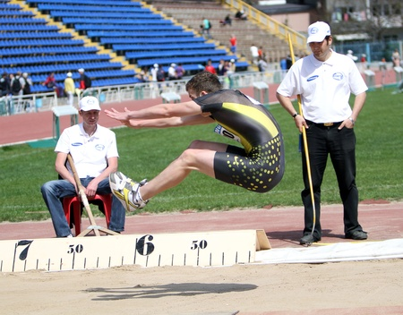 YALTA, UKRAINE - APRIL 25  Zvonskii Igor compete in the long jump competition for boys age 16-17 on Ukrainian Junior Track and Field Championships on april 25, 2012 - Yalta, Ukraine   Stock Photo - 13436614
