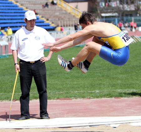 YALTA, UKRAINE - APRIL 25  Chaban Stepan compete in the long jump competition for boys age 16-17 on Ukrainian Junior Track and Field Championships on april 25, 2012 - Yalta, Ukraine  Stock Photo - 13436606