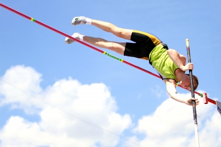 compete: YALTA, UKRAINE - APRIL 25  Telesenko Vladimir compete in the pole vault competition for boys age 16-17 on Ukrainian Junior Track and Field Championships on april 25, 2012 - Yalta, Ukraine   Editorial