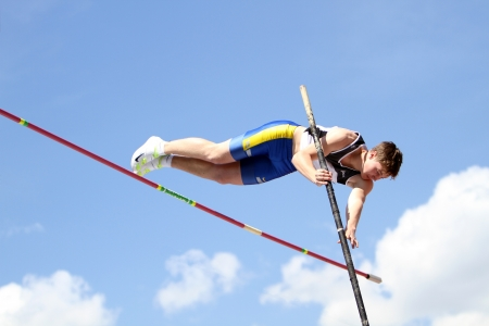 YALTA, UKRAINE - APRIL 25  Kononihin Aleksandr compete in the pole vault competition for boys age 16-17 on Ukrainian Junior Track and Field Championships on april 25, 2012 - Yalta, Ukraine   Editorial