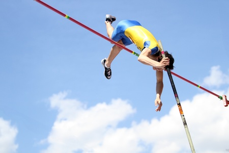 YALTA, UKRAINE - APRIL 25  Kiril Kiru compete in the pole vault competition for boys age 16-17 on Ukrainian Junior Track and Field Championships on april 25, 2012 - Yalta, Ukraine
