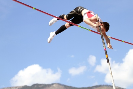 YALTA, UKRAINE - APRIL 25  Haletski Rostislav compete in the pole vault competition for boys age 16-17 on Ukrainian Junior Track and Field Championships on april 25, 2012 - Yalta, Ukraine