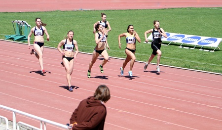 YALTA, UKRAINE - APRIL 25  Unidentified girls age 16-17 on the 200 meters race on Ukrainian Junior Track and Field Championships on April 25, 2012 in Yalta, Ukraine