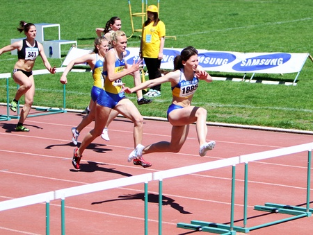 YALTA, UKRAINE - APRIL 25  Unidentified girls age 16-17 on the 100 meters hurdles race on Ukrainian Junior Track and Field Championships on April 25, 2012 in Yalta, Ukraine
