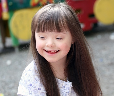 Portrait of beautiful young girl on the playground   photo