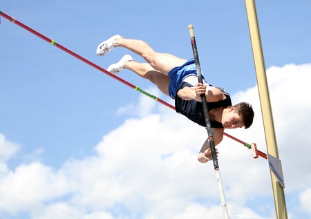 YALTA, UKRAINE - APRIL 25  Kutsenko Sergei compete in the pole vault competition for boys age 16-17 on Ukrainian Junior Track and Field Championships on april 25, 2012 - Yalta, Ukraine