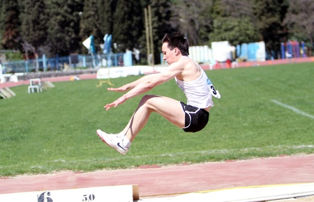 YALTA, UKRAINE - APRIL 25  Klochko Vasil compete in the long jump competition for boys age 16-17 on Ukrainian Junior Track and Field Championships on April 25, 2012 in Yalta, Ukraine
