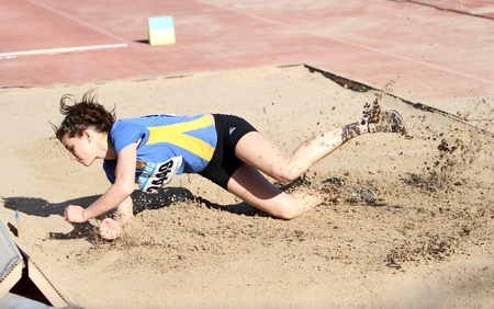 YALTA, UKRAINE - APRIL 25  Senchenko Alina compete in the long jump competition for girls age 16-17 on Ukrainian Junior Track and Field Championships on April 25, 2012 in Yalta, Ukraine