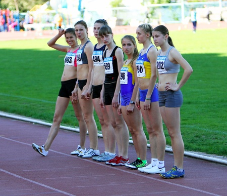 YALTA, UKRAINE - APRIL 25: Unidentified girls age 16-17 on the start of the 400 meters race on Ukrainian Junior Track and Field Championships on April 25, 2012 in Yalta, Ukraine. Stock Photo - 13581128